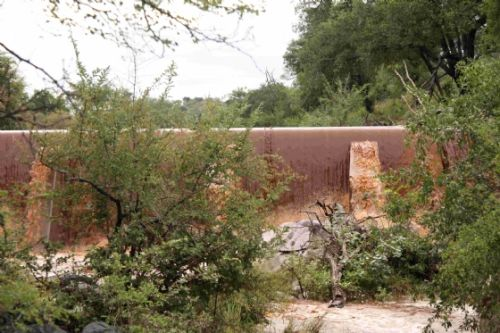 Ndlovu dam overflowing by Graham Benfield